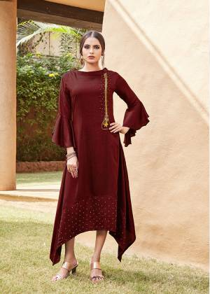 Get For The Upcoming Festive Season With This Readymade Kurti In Maroon Color. This Pretty Kurti Is Beautified With Minimal Hand Work And Available In All Regular Sizes.