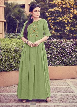 For Your Semi-Casuals Or Social Gatherings, Grab This Designer Readymade Kurti In Light Green Color. It Has Pretty Attractive Hand Work Which Gives A Rich And Elegant Look Over All. Buy Now.