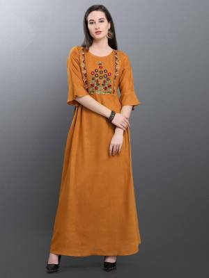 Celebrate This Festive Season With Beauty And Comfort Wearing This Designer Readymade Long Kurti In Musturd Yellow Color Fabricated On Cotton Blend Beautified With Thread Work. It Is Available In All Regular Sizes. Buy Now.