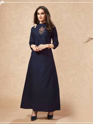 Enhance Your Personality Wearing This Designer Long Kurti In Navy Blue Color. This Cotton based Readymade Kurti Is Beautified With Hand Work Giving It An Attractive Look. Buy Now.