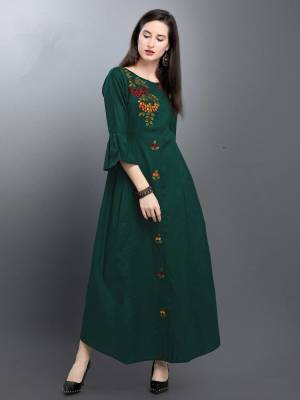For Your Semi-Casual Wear, Grab This Readymade Long Kurti In Dark Green Color. This Kurti Is Silk Based Beautified With Thread Work.