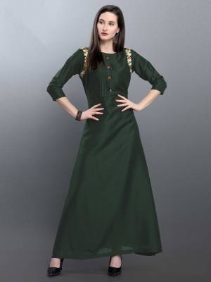 Grab This Deisgner Readymade Long Kurti In Forest Green Color Fabricated On Muslin. This Kurti Is Beautified With Hand Work Near Arm Hole. Buy This Pretty Piece Now.