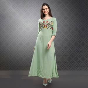 This Season Is About Subtle Shades And Pastel Play, So Grab This Designer Readymade Kurti In Pastel Green Color Fabricated On Rayon Slub. This Fabric IS Soft Towards Skin Which Ensures Superb Comfort All Day Long.