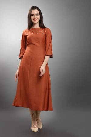 New Shade Is Here To Add Into Your Wardrobe With This Designer Readymade Kurti In Rust Orange Color. This Silk Based Kurti Is Beautified With Small Butti Work. And It Is Easy To Carry And Durable.