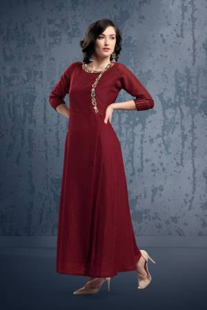 Enhance Your Personality Wearing This Designer Long Kurti In Maroon Color. This Muslin FabricatedReadymade Kurti Is Beautified With Hand Work Giving It An Attractive Look. Buy Now.