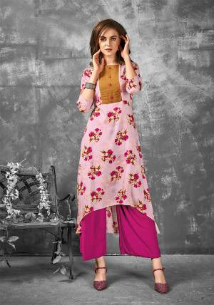 Look Pretty In This Readymade Kurti In Pink Color Fabricated On Rayon. It Is Beautified With Bold Floral Prints All Over It. Buy Now.