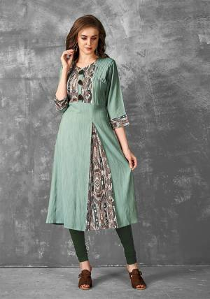 For Your Semi-Casual Wear, Grab This Very Pretty Readymade Kurti In Sea Green Color Fabricated Rayon Slub. It IS Beautified With Pretty Prints And Available In Regular Sizes.