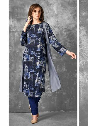 Enhance Your Pesonality In This Readymade Printed Kurti In Navy Blue Color Fabricated on Cotton. It Is Light In Weight And Easy To Carry All Day Long.