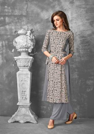 Rich And Elegant Looking Readymade Kurti Is Here In Sand Grey Color Fabricated On Rayon. This Kurti Is Beautified With Small Floral Prints. Its Pretty Color And Print Will Earn you Lots Of Compliments.
