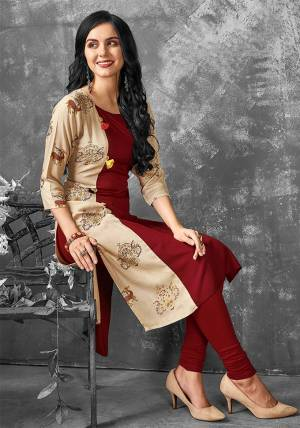 Add This Pretty Kurti To Your Wardrobe In Maroon And Beige Color Fabricated On Cotton. It Is Light In Weight And Easy To Carry All Day Long.