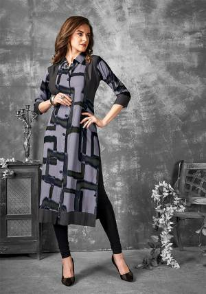 Grab This Simple Readymade Kurti For Your Casual Wear In Grey Color Fabricated on Cotton. It Is Beautified With Unique Prints All Over.