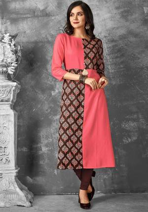 Look Pretty In This Readymade Kurti In Pink And Brown Color Fabricated On Rayon. It Is Beautified With Bold Prints with A Very Unqiue Pattern. Buy Now.