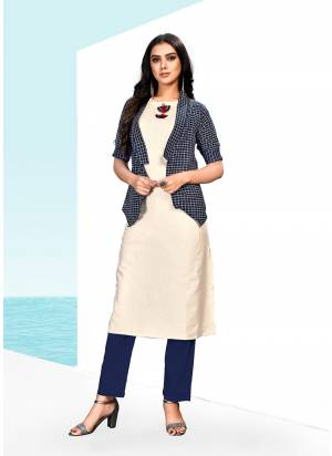 Simple And Elegant Looking Designer Readymade Kurti Is Here In Off-White & Navy Blue Color Fabricated On Khadi Cotton. It IS Beautified With Checks Prints And Fancy Buttons.