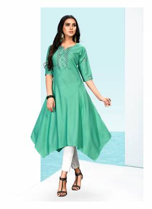 Asymetric Patterned Designer Readymade Kurti IS Here In Sea Green Color Fabricated On Khadi Cotton Beautified with Multi Colored Thread Work.