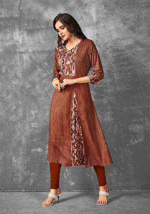 Enhance Your Personality Wearing This Readymade Kurti In Brown Color Fabricated On Rayon. Its Fabric Is Soft Towards Skin And Easy To Carry All Day Long.