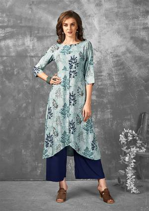 Look Pretty In This Designer Readymade Kurti In Sky Blue Color Fabricated On Rayon. It Is Beautified With Prints In Multiple Shades Of Blue. It Is Light Weight, Durable And Easy To Carry All Day Long.