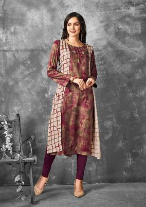 Simple And Elegant Looking Readymade Kurti Is Here In Brown And Magenta Pink Color Fabricated On Rayon. This Kurti Is Light In Weight And Easy To Carry All Day Long.