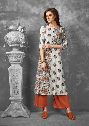 Enhance Your Personality Wearing This Readymade Kurti In Off-White Color Fabricated On Rayon. Its Fabric Is Soft Towards Skin And Easy To Carry All Day Long.