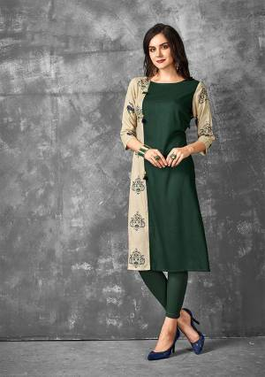 Here Is A Very Beautiful Designer Straight Kurti In Dark Green And Beige Color Fabricated On Rayon. This Readymade Kurti Is Available In all Regular Sizes And Ensures Superb Comfort All Day Long.