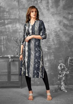 Add This Very Pretty Designer Readymade Kurti To Your Wardrobe In Dark Grey Color Fabricated On Rayon. This Pretty Kurti Is Beautified With Abstract Floral & Lining Prints All Over.
