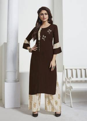 Enhance Your Personality Wearing This Readymade Pair In Brown Colored Kurti Paired with Contrasting Cream Colored Bottom. Its Top Is Fabricated On Rayon Slub Paired With Rayon Fabricated Bottom. Its Bottom And Pretty Foil Prints And Hand Work On Kurti. Buy Now.