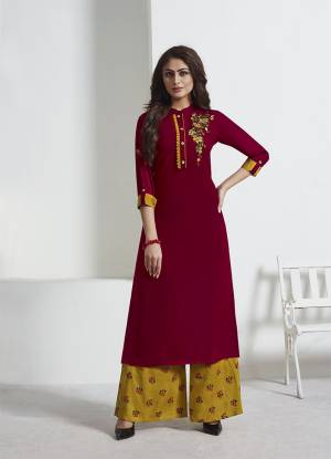 Get Ready For The Upcoming Festive Season With This Readymade Designer Pair Of Kurti And Pant In Maroon Colored Paired With Contrasting Musturd Yellow Colored Bottom. Its Top IS Fabricated On Rayon Slub Paired With Rayon Fabricated Bottom.