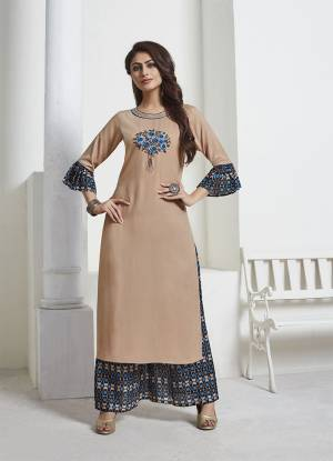 Simple and Elegant Looking Designer Readymade Pair Is Here In Beige Colored Top Paired With Black And Blue Colored Bottom. This Kurti Is Fabricated On Rayon Slub Paired With Silk Based Bottom. Buy Now.