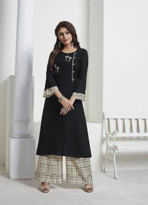 For A Bold And Beautiful Look, Grab This Designer Readymade Pair Of Kurti And Pant In Black And Cream Color. Its Top IS Fabricated On Rayon Slub Paired With Muslin Fabricated Bottom. Grab This Lovely Rich and Elegant Looking Piece Now.