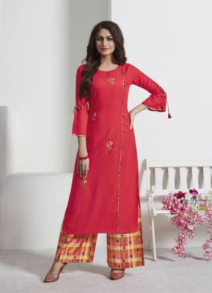 Attract All Wearing This Readymade Pair Of Kurti And Pants In Crimson Red Colored Top Paired With Multi Colored Bottom. Its Top Is Fabricated On Rayon Slub Paired With Soft Silk Fabricated Bottom. Both Its Fabric Are Light Weight And Easy To Carry All Day Long.