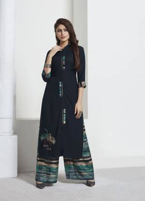 For Your Semi-Casual Or Social Gatherings, This Lovely Pair Of Kurti And pants Is Here In Navy Blue Colored Top Paired With Multi Colored Bottom. This Pair Is Rayon Based Beautified With Prints And Thread Work. Buy Now.