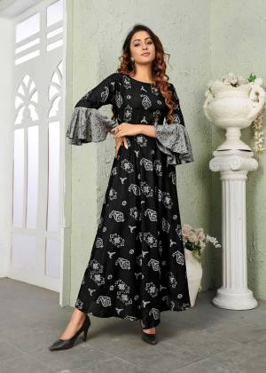 For A Bold And Beautiful Look, Grab This Designer Readymade Gown In Black Color Fabricated On Muslin. This pretty Gown Is Beautified With Prints All Over With Bell Sleeve Pattern.
