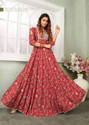 This Festive Season, Grab This Beautiful Designer Readymade Gown In Red Color Fabricated On Muslin. This Gown Is Beautified With Prints All Over And It Is Available In All Regular Sizes.