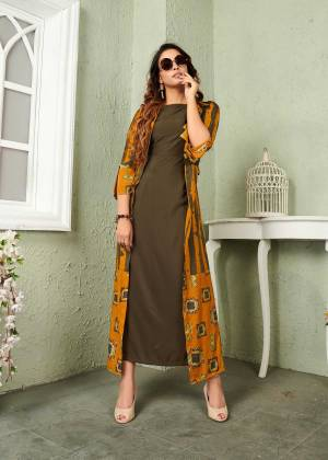 Add This Beautiful And Trendy Designer Piece To Your Wardrobe In Olive Green And Musturd Yellow Color. It Is Fabricated On Muslin Beautified With Prints And Thread Work.