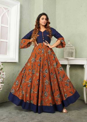 New And Unique Color Pallete Is Here Is Here With This Designer Readymade Gown In Rust And Navy Blue Color Fabricated On Muslin. It Is Beautified With Prints Which Is Light Weight, Durable And Easy to Carry All Day Long.