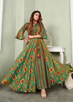 Here Is A Very Pretty Designer Readymade Gown In Green And Brown Color Which Is Fabricated On Muslin And Beautified With Prints All Over. This Gown Is Light Weight And easy To Carry Throughout The Gala.