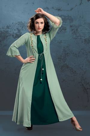 Here Is A Very Beautiful Designer Kurti With Jacket Is Here In Pine And Pastel Green Color. Is IS Fabricated On Muslin Which IS Soft Towards And Is Beautified With Minimal Hand Work Giving It An Elegant Look.