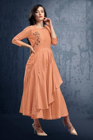 Grab This Pretty Peach Colored Readymade Kurti Which IS Silk Based. This Kurti Has Double Layered Pattern With Hand Work Over The Yoke. Buy This Kurti Now.