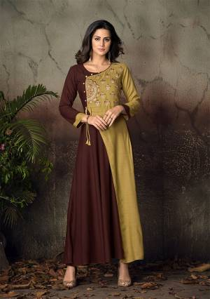 Simple and Elegant Looking Designer Readymade Gown Is Here In Brown And Pear Green Color Fabricated On Rayon. It Is Beautified With Attractive Thread Work Over The Yoke. Buy Now.