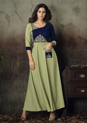 Adorn The Pretty Angelic Look Wearing This Readymade Deisgner Gown In Light Green Color Fabricated On Rayon Beautified With Thread Embroidery. Its Pretty Color And Embroidery Over Yoke Is Making An OverAll Beautiful Piece. Buy Now.