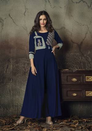 Celebrate This Festive Season With Beauty And Comfort Wearing This Designer Readymade Gown In Navy Blue Color Fabricated On Rayon. It Is Beautified With Thread Work. Its Fabric Is Soft Towards Skin And Easy To Carry All Day Long.