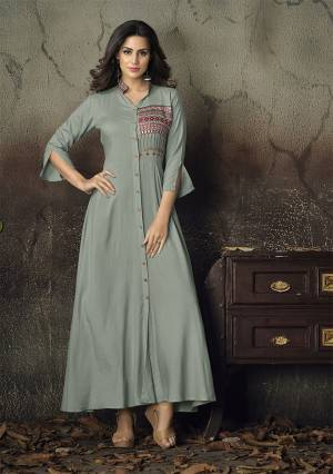For A Rich And Subtle Look, Grab This Designer Readymade Gown In Grey Color Fabricated On Rayon. It Has Very Beautiful Sleeve Pattern With Embroidery Over The Yoke.