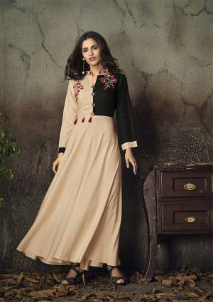 Simple and Elegant Looking Designer Readymade Gown Is Here In Peach And Black Color Fabricated On Rayon. It Is Beautified With Attractive Thread Work Over The Yoke. Buy Now.