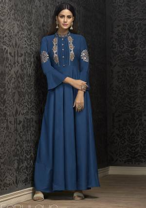 Grab This Very Beautiful Designer Readymade Gown In Blue Color Fabricated On Muslin. This Pretty Gown Is Beautified with Attractive And Elegant Looking Minimal Embroidery Which Earn You Lots Of Compliments From Onlookers.