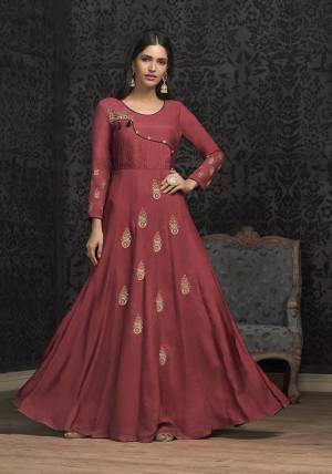Celebrate This Festive Season With Beauty And Comfort Wearing This Designer Piece In Dark Pink Colored Readymade Gown. This Pretty Gown Is Muslin Based Beautified With Attractive Embroidery. Buy Now.