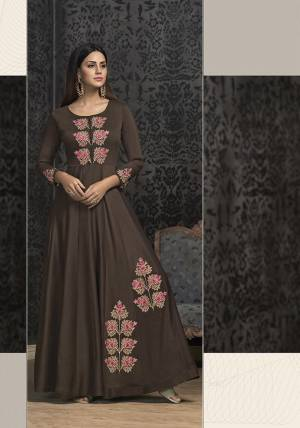 Rich And Elegant Looking Designer Readymade Gown Is Here In Dark Brown Color Which IS Near To Black. It IS Fabricated On Muslin With Very Pretty Atractive Embroidery. Buy This Lovely Piece Now.