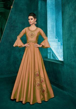Simple And Elegant Looking Designer Readymade Gown Is Here In Beige Color Fabricated On Soft Art Silk Beautified With Attractive Embroidery Over The Yoke And Panel.