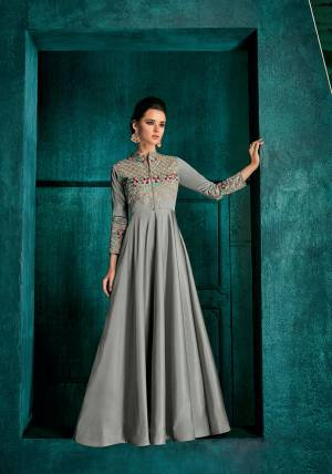 Flaunt Your Rich And Elegant taste In This Very Pretty Designer Readymade Gown In Grey Color Fabricated On Soft Art Silk Beautified With Attractive Embroidery With Jari And Contrasting Threads. Buy Now.