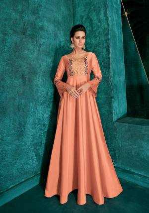 Grab This Very Beautiful Designer Readymade Gown In Dark Peach Color Fabricated On Soft Art Silk Beautified With Attractive Embroidery Over Yoke And Sleeves. Its Pretty Color And Embroidery Will Give An Attractive Look To your Personality.