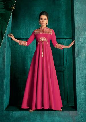 Bright And Visually Appealing Color Is Here With This Very Beautiful Designer Readymade Gown In Dark Pink Color Fabricated Soft Art Silk. It Is Beautified With Minimal Elegant Looking Embroidery Which Will Earn You Lots Of Compliments From Onlookers.
