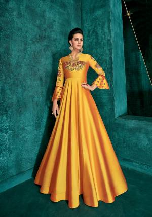 Celebrate This Festive Season Wearing This Designer Readymade Gown In Musturd Yellow Color Fabricated On Soft Art Silk Beautified With Embroidery. Its Rich Fabric And Color Will Definitely Earn You Lots Of Compliments From Onlookers.